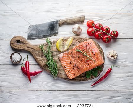 Fresh salmon on the cutting board. Cooking process.