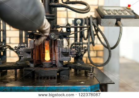 glass bottle production factory - machine blowing of molten glass