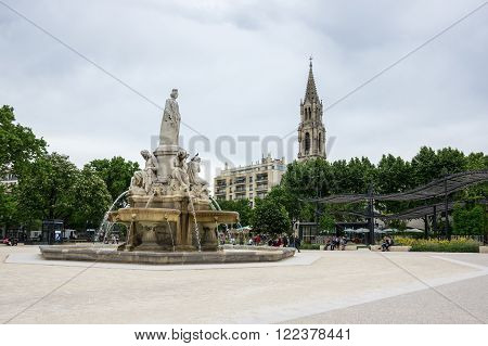 NIMES, FRANCE - MAY 04, 2015: Esplanade Charles de Gaulle of Nimes. Nimes is a famous and very popular among tourists city in Provence in south of France