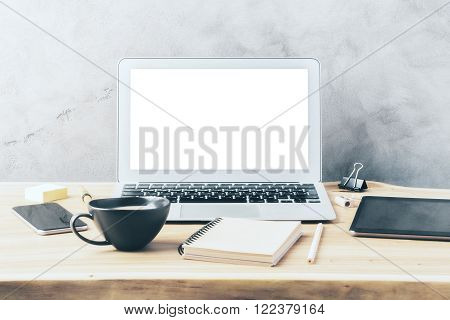 Blank Laptop Screen On A Wooden Slab With Coffee Cup, Notebook And Cell Phone, Mock Up