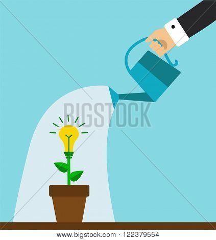 hand holding a watering can and water the plants symbolizing the business idea