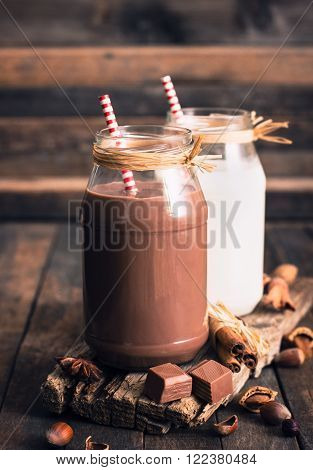 Chocolate and regular milk in the glass jar