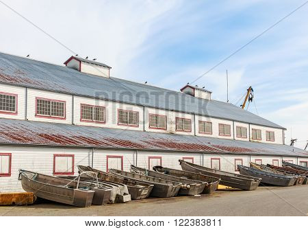 Industrial warehouse and boats in the fishing port.