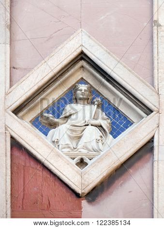 FLORENCE, ITALY - JUNE 05: Sun by Collaborator of Andrea Pisano, 1337-41., Relief on Giotto Campanile of Cattedrale di Santa Maria del Fiore, Florence, Italy on June 05, 2015