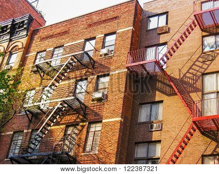 Typical building with fire escapes on the facade in New York City, United States.