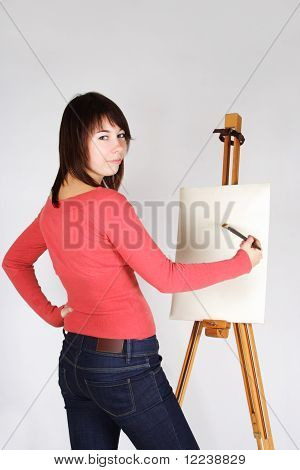 Young Girl In Red Shirt Standing Near Easel, Painting And Looking Back
