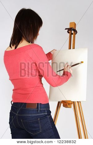 Young Girl In Red Shirt Standing Near Easel And Painting, Back View