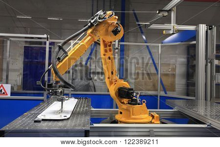 Industrial robotic arm in electronics production line
