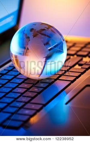 glass globe on a laptop keyboard