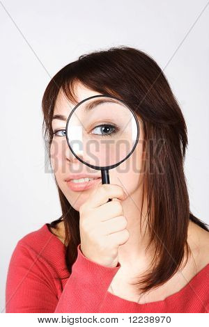 Young Woman Holding Magnifier And Looking Through It, Big Eye