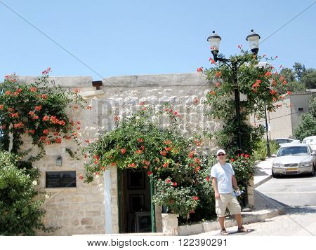SAFED, ISRAEL - JUNE 29, 2008: The house with bougainvillea on June 29, 2008 in Old City Safed, Israel