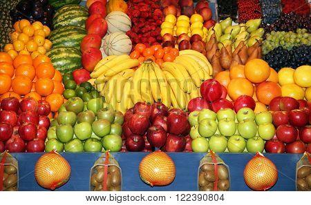 Set Of Freshly Picked Organic Fruits At Market Stall