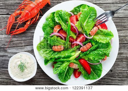 crawfish salad with cos lettuce top view close-up