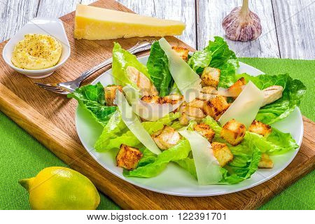 classic Caesar salad lettuce croutons parmesan cheese and chicken breast