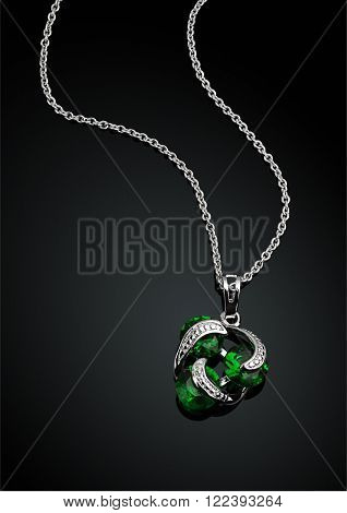 jewellery pendant with green emerald on darck
