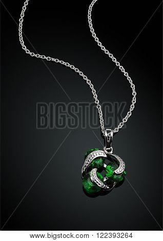 jewellery pendant with green emerald on darck