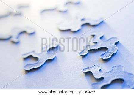 puzzle pieces with shallow depth of field in blue light