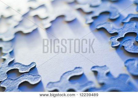 puzzle pieces with copy space and shallow depth of field in blue light