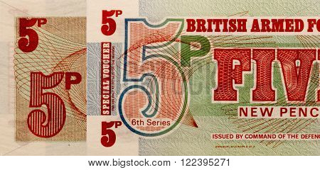 paper money British Armed Forces 5 Pence.view from above .collage