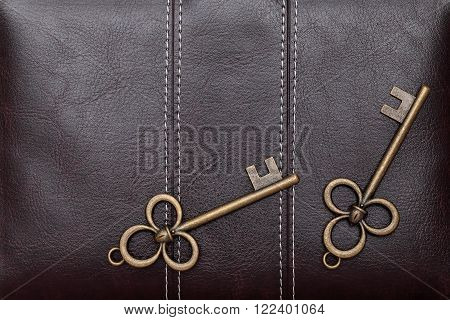 Vintage door key on a brown leather background