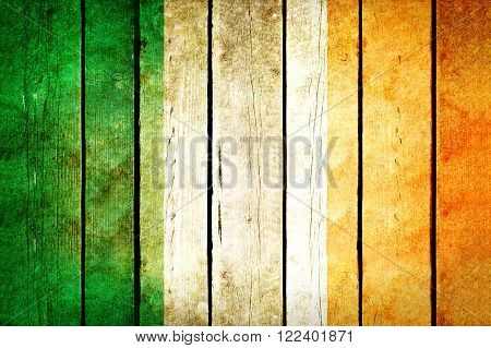 Ireland wooden grunge flag. Ireland flag painted on the old wooden planks. Vintage retro picture from my collection of flags.
