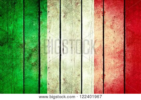 Italy wooden grunge flag. Italy flag painted on the old wooden planks. Vintage retro picture from my collection of flags.