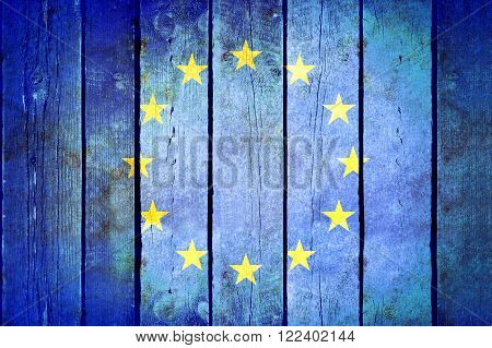 European Union wooden grunge flag. European Union flag painted on the old wooden planks. Vintage retro picture from my collection of flags.