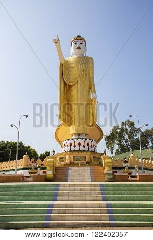 The pointing Buddha statue at Wat Jom Sak Temple in Kengtong (Kyaing tong) city, Shan State, Myanmar.