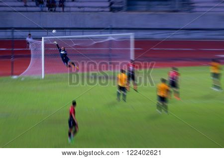 Blur image of Thai goalkeeper whose defending a goal during a soccer game