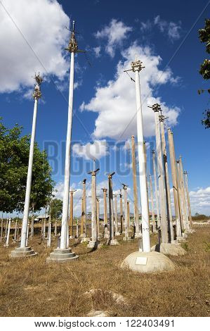 LOIKAW, MYANMAR - JANUARY 24, 2016: An animist ritual place near Loikaw, Myanmar. The place is used to put some of the harvest beneath the poles as a thanksgiving to the gods.