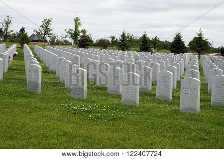 ELWOOD, ILLINOIS / UNITED STATES : MAY 31, 2015: Rows of graves at the Abraham Lincoln National Cemetery in Elwood.
