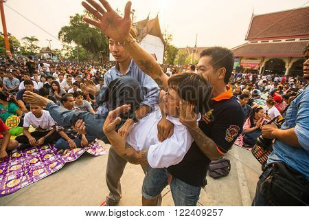 WAT BANG PHRA, THAILAND - MART 19, 2016: Unknown participants Master Day Ceremony at able Khong Khuen - spirit possession during the Wai Kroo ritual at Bang Pra monastery, about 50 km west of Bangkok.