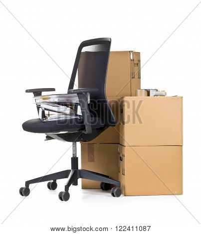 Office folder on office chair in front of moving boxes over white background - office moving or relocation concept