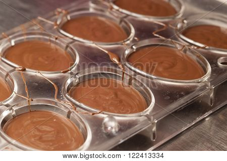Ingredients and preparation of italian Easter milk and dark choccolate eggs and sweets