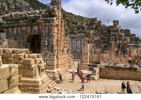 Demre-Myra Turkey - April 26 2014: Antique Theatre. The theater was one of the most common and welcome sight of the citizens but the role played only by men men's changing masks on zhenskie.Turisty see the sights and take pictures.
