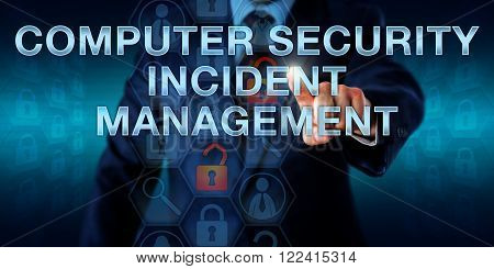 Man is pressing COMPUTER SECURITY INCIDENT MANAGEMENT on a touch screen interface. business metaphor and information technology concept for monitoring security events on a computer system or network.