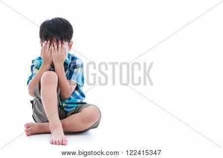 Full body. Little sad boy covered his face with hands. Isolated on white background. Negative human emotions. Conceptual about children who lack warmth and affection. Free form copy space.