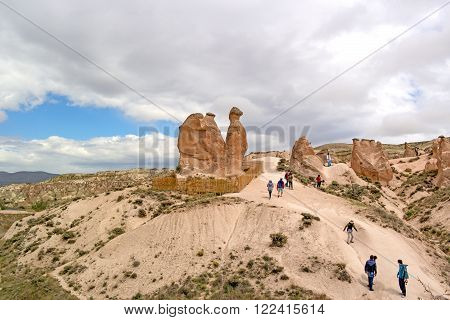 A geological formation Camel consisting of volcanic tuff. Cappadocia in Central Anatolia is a UNESCO World Heritage Turkey. Tourists sightseeing.