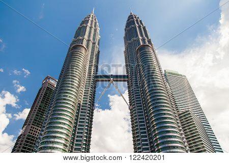 KUALA LUMPUR MALAYSIA - February 01 2013. The Petronas Twin Towers on sky background in sunny day.