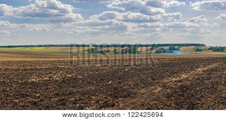 Ukrainian agricultural landscape with ploughed field at fall season