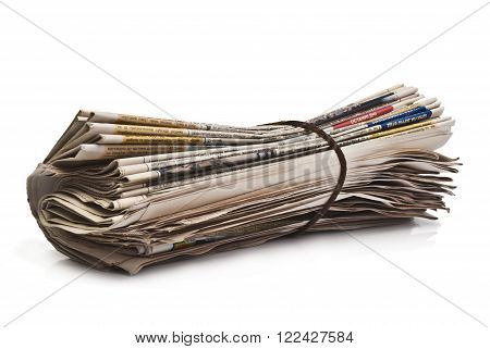 Rolled up newspaper cord. Isolated on white background.