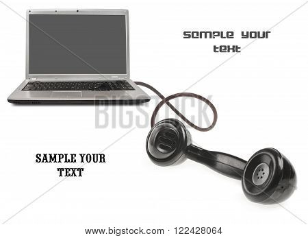 communication concept. The laptop and handset on a white background