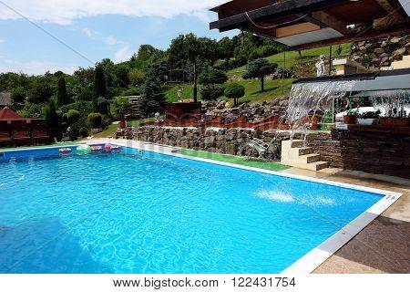 Mala Trna PRESOV SLOVAKIA - JULY 18 2014: Swimming-pool and building in Mala Trna village Presov region Slovakia.