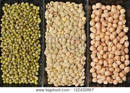Chickpeas, Lentils And Mung Beans In Black Plate