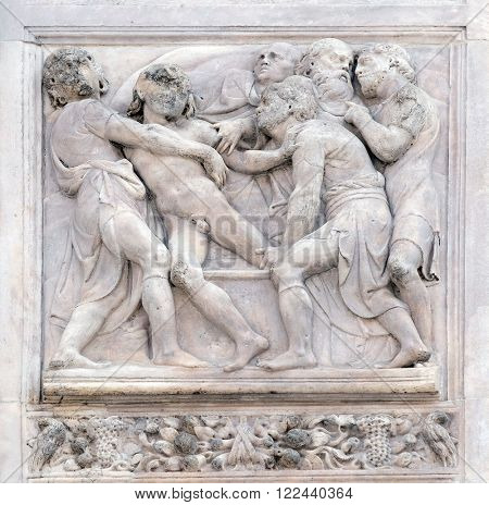 BOLOGNA, ITALY - JUNE 04: Joseph thrown into the cistern by Amico Aspertini, right door of San Petronio Basilica in Bologna, Italy, on June 04, 2015