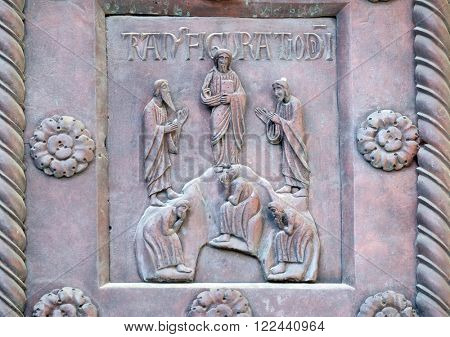 PISA, ITALY - JUNE 06, 2015: Transfiguration of Christ on the San Ranieri gate of the Cathedral St. Mary of the Assumption in Pisa, Italy on June 06, 2015