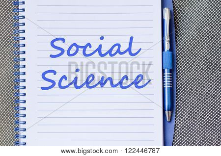 Social science text concept write on notebook with pen