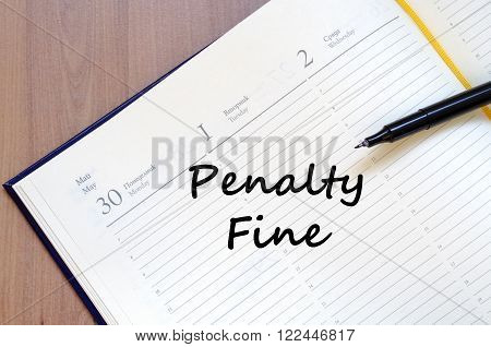 Penalty fine text concept write on notebook with pen