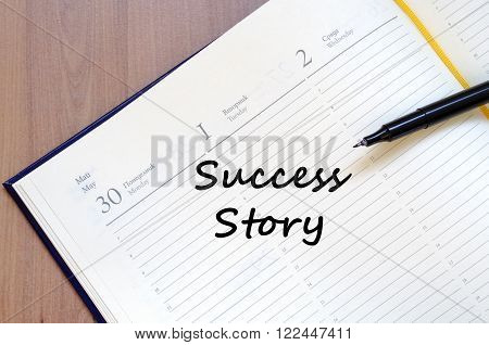 Success story text concept write on notebook with pen