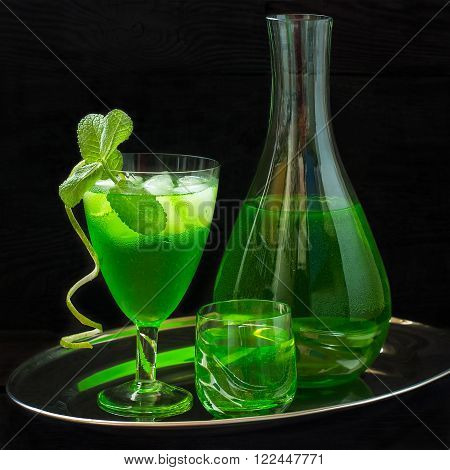 Cocktail with tarragon mint and ice on a metal tray. Square image